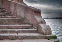 The staireway to Neva river waters in SaintPetersburg. HDR view of the stairway to Neva river waters in SaintPetersburg on the Palace embankment one november Stock Image