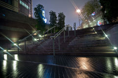 Stairs. Block stairs at night with blur lights when raining Stock Photography