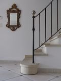 Stairs. Stone stairs in villa with bannister and mirror on wall stock images