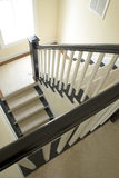 Stairs. Carpeted stairs inside new house Stock Photography