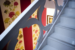 Stairs. The white blue stairs and beautiful wallpaper Stock Images