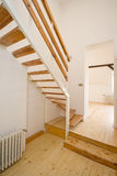 Stairs. New wooden stairs in bright interior Royalty Free Stock Images