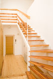 Stairs. New wooden stairs in bright interior Stock Photography