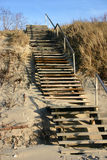 Stairs. Wooden stairs in the white sand Stock Photography