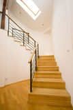 Stairs. New wooden stairs in bright interior Stock Image