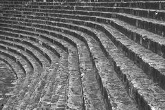 Stairs. Gray stairs or steps or seating in arena, curving around into distance Stock Photo