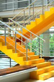 Stairs. Yellow colored stairs of a building (indoor Stock Photo