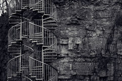 Stairs. Spiral stairs on the stone wall Stock Image