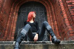 Stairs. Girl with red hair is sitting on the stairs Royalty Free Stock Photo