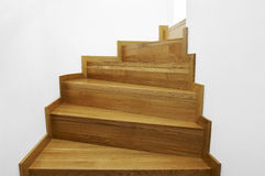 Stairs. Wooden stairs with white walls leading up Stock Image