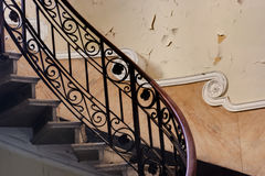 Stairs in an abandoned building. In an abandoned mansion, a sinuous handrail Stock Photo