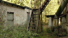 Stairs of the abandoned factory. Autumn daytime. Smooth dolly shot.  stock footage