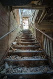 Stairs in an abandoned insane asylum. Steps in an old abandoned asylum Royalty Free Stock Photo