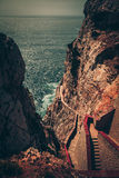 Stairs along the coastal rocks. Steep stairs down to the sea stock photography