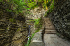 Stairs along the Watkins Glen Gorge Trail. Steps along the Watkins Glen trail leading to a bridge Royalty Free Stock Image