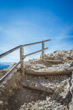 Stairs on an alpine trekking route seemingly leading to the heav Stock Photos