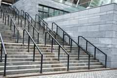 Stairs. Angle view of main stairs with metal handrails on sport stadium stock photo