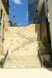 Sandstone stairs apartments. Stairs between two blocks of apartments with a lovely blue sky in background. Copyspace royalty free stock photography