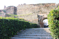 Stairs and Arc. Cut bushes with stairs leading to the arc in a fortified old wall in Thessaloniki, Northern Greece Stock Images