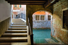 Stairs, archway and canal in Venice stock photography