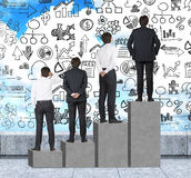 Stairs as a huge concrete bar chart are on the roof. Businessmen are standing on each step as a concept of range of problems or le Royalty Free Stock Photography