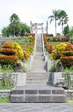 Stairs and Balinese Decorations in a Park. Stairs with lion statues leading to arc decoration in Taman Ujung water palace garden and park. Photo taken in Bali Stock Photo