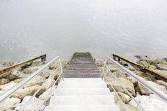 Stairs on the beach. Detail of some ancient stairs stock photography