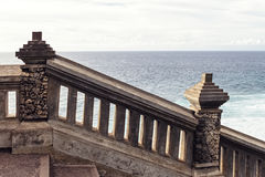 The stairs and the blue ocean. In the background stock images
