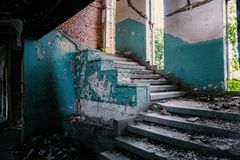 Stairs and broken windows in an abandoned, disaffected building stock photos