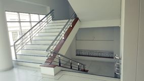 Stairs in the building empty modern office building interior. stock photography
