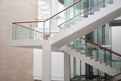 Stairs in the building. Stairs with glass rail in the building Stock Photo