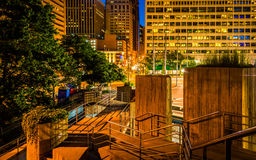 Stairs and buildings at night at the Inner Harbor in Baltimore, Royalty Free Stock Images