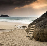 Stairs carved into rock on beautiful beach Royalty Free Stock Image