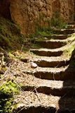 Stairs into a cave. Some stairs into a cave royalty free stock image