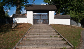 Stairs and cemetery gate in Oravsky Biely Potok. Village in Orava region in Slovakia royalty free stock photo
