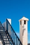 Stairs, chimney and blue sky Stock Image