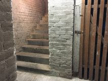 Stairs in a clean cellar Stock Images
