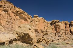Stairs on cliff face in New Mexico. Chaco Canyon Pueblo, New Mexico. Look toward the middle of the photo and you`ll see stairs carved into the cliff face by royalty free stock image