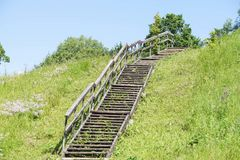 Stairs climb up the road to the sky. Outdoors the field of grass and flowers Stock Images