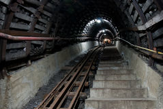 Stairs in coal mine. Stairs and tracks in coal mine, modern construction royalty free stock photography
