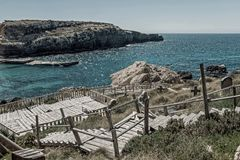 Coastline at Popeye Village in Malta. Stairs at coastline at Popeye Village in Malta n Royalty Free Stock Images