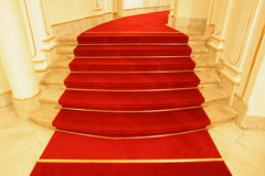 Stairs covered red carpet Stock Photo