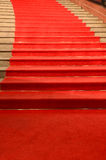 Stairs covered with red carpet Stock Photo