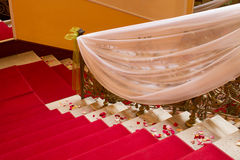 Stairs covered with red carpet Royalty Free Stock Image