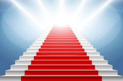 Stairs covered with red carpet. Scene illuminated by a spotlight Royalty Free Stock Images