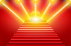 Stairs covered with red carpet. Scene illuminated by a spotlight Royalty Free Stock Photo