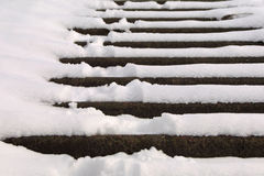 Stairs covered with snow Stock Photos