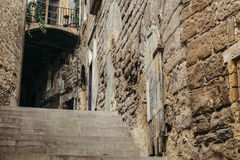 Stairs on a dark tunnel on a medieval narrow street Stock Images