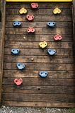 Stairs of different colors on a wooden plank, wooden ladder of a children`s pool. beautiful toys background stock photos