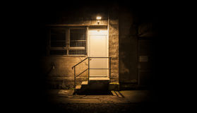 Stairs and door illuminated in the night Royalty Free Stock Photo